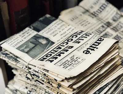 Photo of two stacks of bundled newspapers