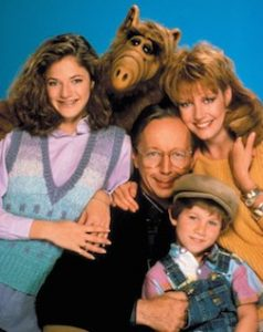 Promotional family photo from TV show ALF, with alien.