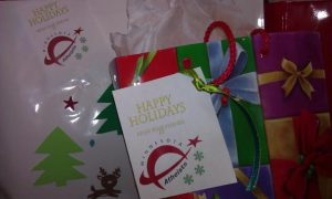 """Photo of wrapped gifts with tags saying, """"Happy holidays from your friends at Minnesota Atheists."""""""