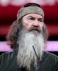 Photo of Phil Robertson speaking. Mostly hair and beard.