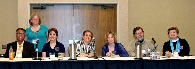 Photo of panelists behind a table