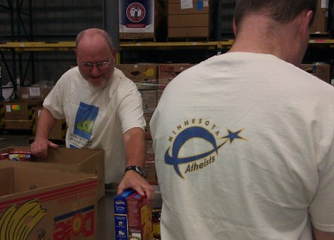 Photo of Steve packing boxes at food bank