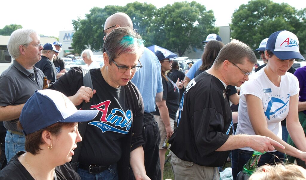 Photo of several people tailgating in Aints shirts