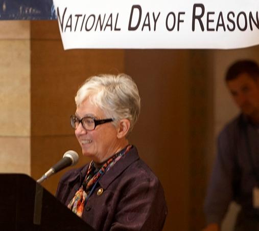 Photo of Rep. Kahn at a podium.