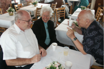 Photo of Otto seated at a table with others.