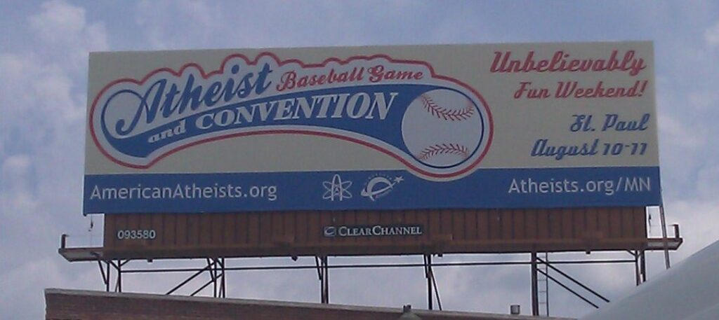 Photo of billboard advertising convention and game.