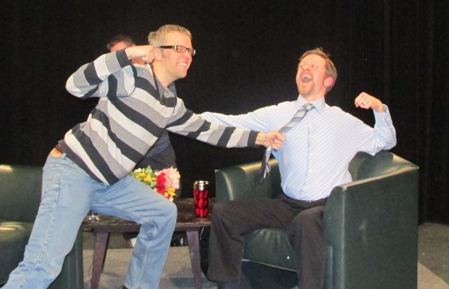 Photo of Eric and James playfighting on the set.