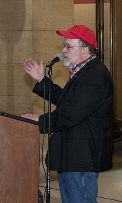 Photo of speaker at podium.
