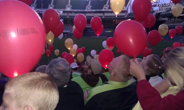 Photo of crowd with balloons.