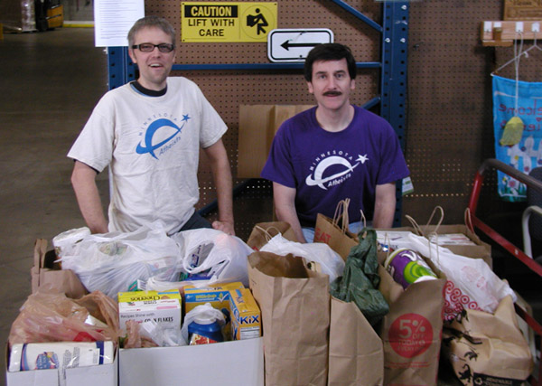 Photo of members with bags of groceries.