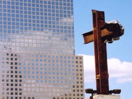 Photo of girder fragments in the shape of a cross from the remains of the World Trade Center.