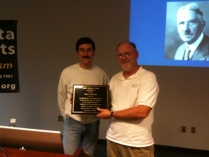 Photo of Jack and Steve with plaque.