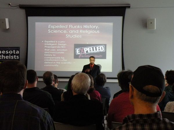 Photo of Hector Avalos presenting.