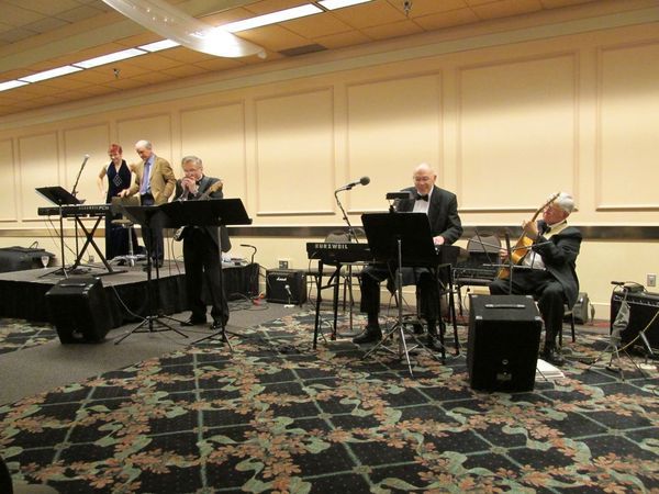 Photo of band performing at Solstice dinner.