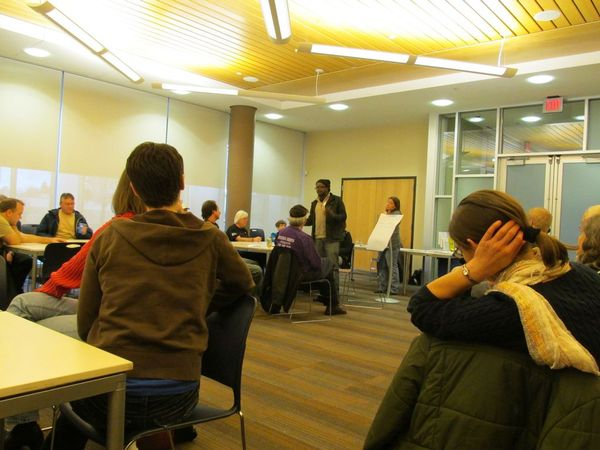 Photo of attendee speaking for his small group.
