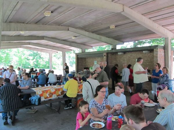 Photo of attendees seated in the picnic pavilion.