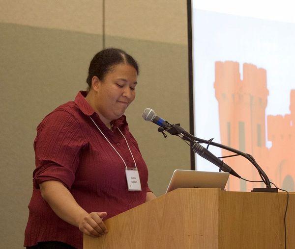 Photo of Debbie Goddard speaking.