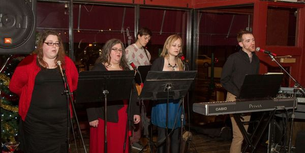 Photo of Sunday Assembly singers at Solstice dinner.