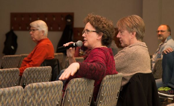 Photo of Nancy asking a question from audience.