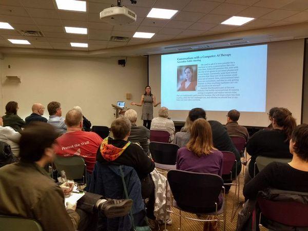 Photo of Danielle MacDonald presenting.