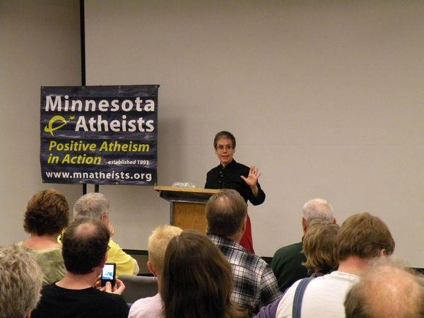 Photo of Greta Christina presenting.