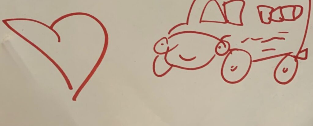 Line drawing of school bus and heart.